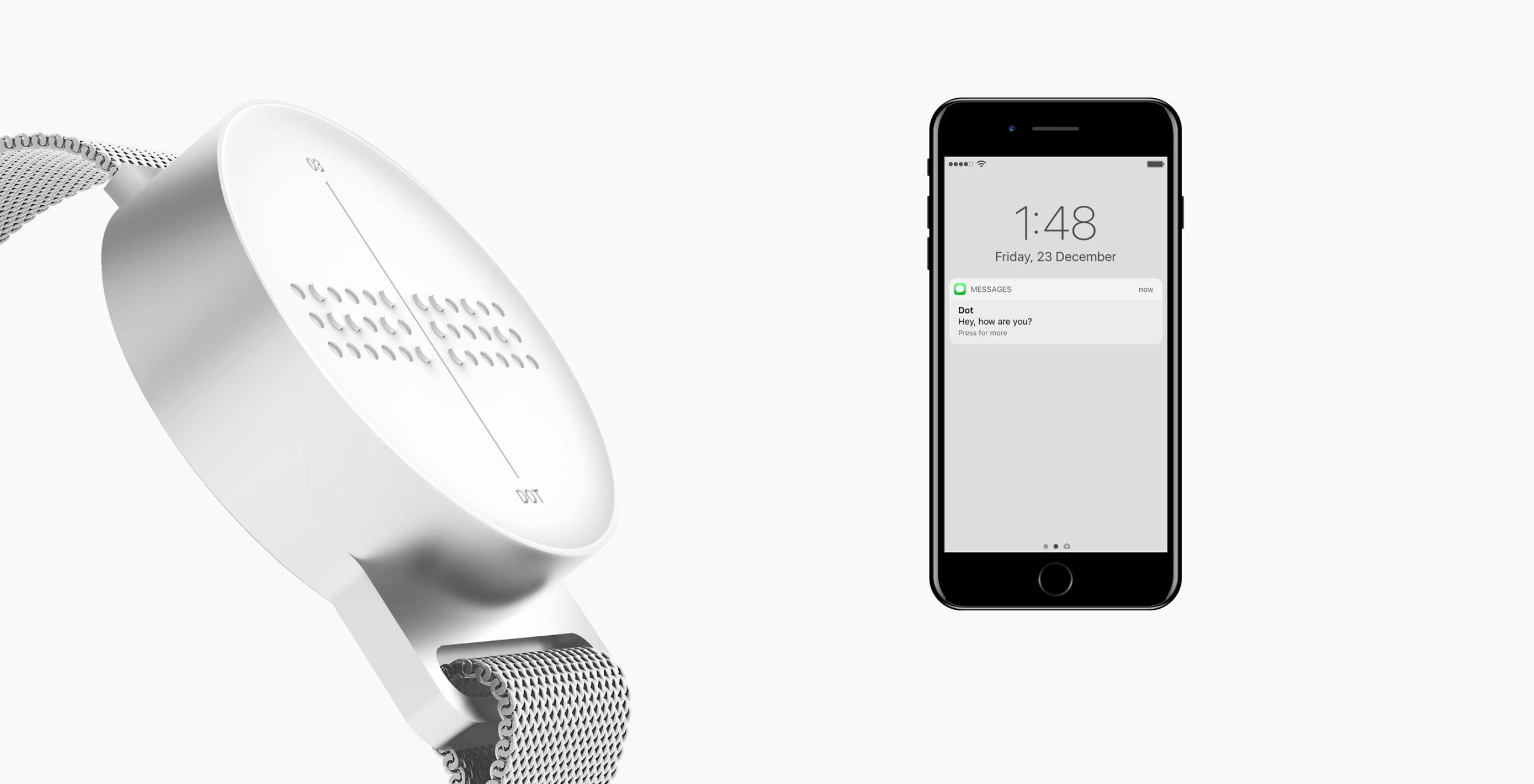 Bild 2: Eine Smartwatch mit erhobener 3-D Brailleschrift ist zu sehen. Daneben eine Smartphone.